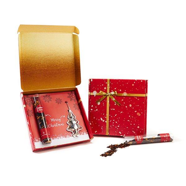 Kerst thee met kerstboominfuser in verzendverpakking